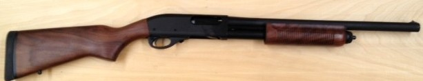 "This is our stock Remington 870 Police as provided.  Walnut stock, parkerized finish, and 18"" bead sight barrel."