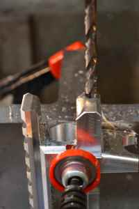 """After the #16 bit, a 1/4"""" drill is sued to drill a .700"""" deep counterbore to provide clearance for the barrel hold down screw shank."""