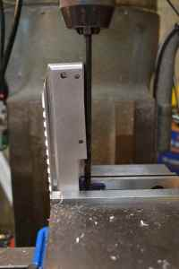 "The receiver is secured at a 3 degrees and the 5/16"" long drill is used to drill a .250"" deep magazine detent hole."