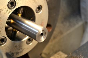 A recess was cut in the threaded part of the muzzle and a slight taper cut into the thread protector.
