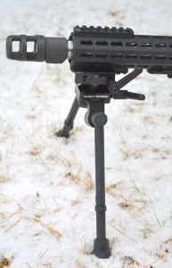Bipod legs locked perpendicular to rifle.