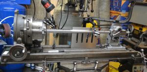 """I start by aligning the taper of the barrel parallel to the milling machine. I use a .001"""" dial indicator on a long magnetic base to zero in the barrel. Note the large angel plate behind the barrel. This is essential to eliminating chatter and providing a rigid set up for cutting the flutes."""