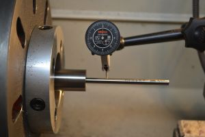 "To crown the barrel I dial in the bore on the lathe.  I'm using a Gre-tan tooling #2 range rod with a .0001"" indicator.  Range rods have a provision for a bushing and a gradual taper.  The rod is center by the bushing and the taper."