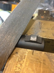 The bead on the bead base of the barrel needs to be removed.  On most 870s this is pinned and soldered in place and you can't unscrew it.  A file makes short work of removing it.