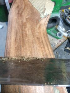 To remove the layers of old wood finish and spray paint I use a cabinet scraper.