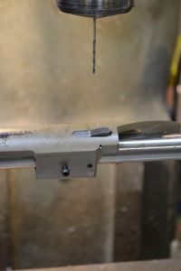 Test fitting the bolt stop prior to removing the action from the mill ensures the cuts were made to the proper depth.