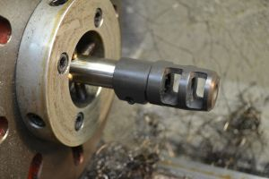 """Finally the brake is installed on the end of the barrel.  A boring bar is used to open the brake to .020"""" over bore diameter."""
