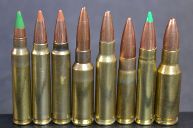"AR-15/M16 cartridge line up (left to right): 223 Remington/5.56mm NATO, 6.5 PCC virgin brass, 6.5 PCC fire formed brass, 6.5 Grendel, 6.8 SPC, 300 AAC BLK, 7.62x40 WT and 30AR. Note the relatively short (.145"") neck on the 6.5 PCC."