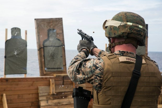 Cpl. Ransom W. Harrist fires the M9A1 9 mm service pistol Nov. 1 on the flight deck of the USNS Sacagawea. Marines trained with the service pistol and enhanced marksmanship fundamentals. The Marines are participating in T-AKE 14-2, a maritime pre-positioned force, multi-country theater security cooperation deployed from Okinawa aboard the USNS Sacagawea in the Asia-Pacific area of operations. Harrist, from Shallowater, Texas, is a landing support specialist with Combat Logistics Detachment 379, Headquarters Regiment, 3rd Marine Logistics Group, III Marine Expeditionary Force. (U.S. Marine Corps photo by Cpl. Drew Tech/Released)