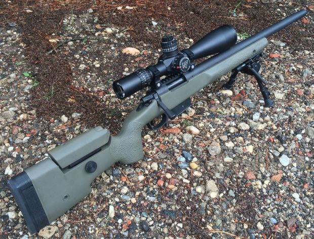 6,5 creedmoor custom rifle on gravel