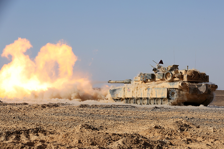 An M1A1 Abrams Main Battle Tank with Kilo Company, Battalion Landing Team 3rd Battalion, 6th Marine Regiment, 24th Marine Expeditionary Unit, fires its 120 mm smoothbore cannon during a live-fire event as part of Exercise Eager Lion 2015 in Jordan, May 9, 2015. Eager Lion is a recurring multinational exercise designed to strengthen military-to-military relationships, increase interoperability between partner nations, and enhance regional security and stability. The 24th MEU is embarked on the ships of the Iwo Jima Amphibious Ready Group and deployed to maintain regional security in the U.S. 5th Fleet area of operations. (U.S. Marine Corps photo by Sgt. Devin Nichols)