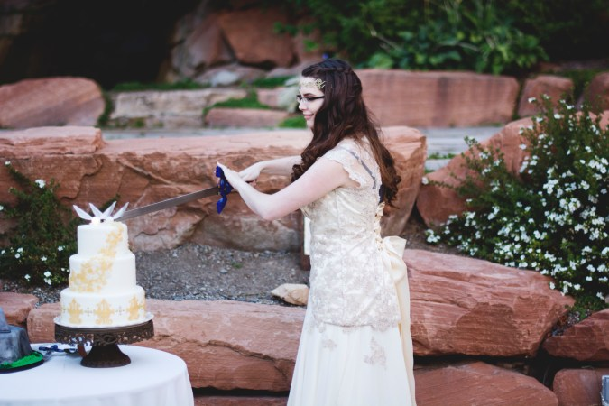Bride Cutting Zelda Wedding Cake