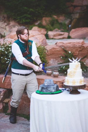 Groom Cutting Zelda Cake 2