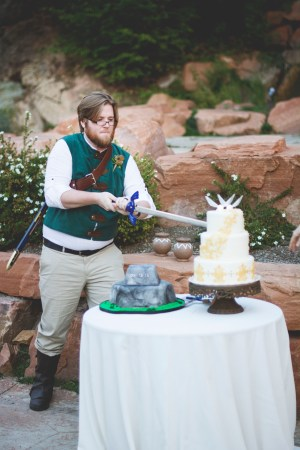 Groom Cutting Cake with Master Sword
