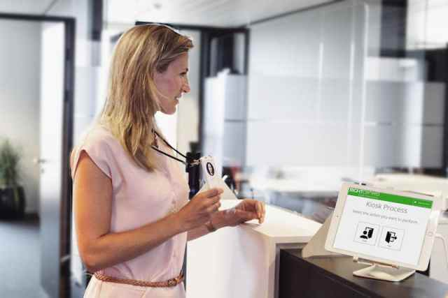 Contactless visitor sign in at the reception desk