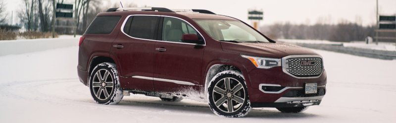 2017 GMC Acadia in red on snow