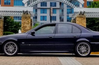 Carbon Black 2002 BMW M5 side shot