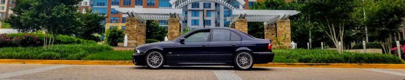 Carbon Black 2002 BMW M5 side shot
