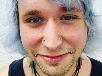 double nostril and dahlia piercing