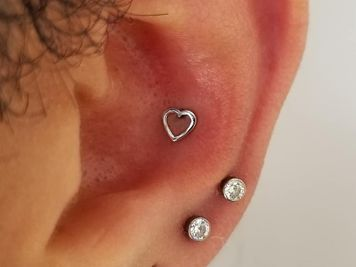 mens conch piercing