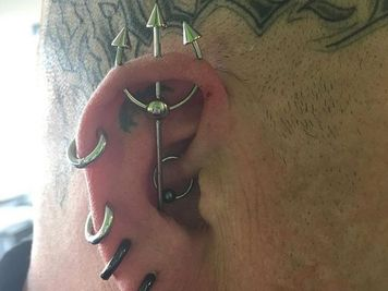 trident piercing on ear