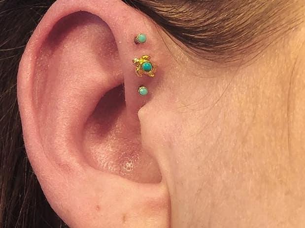 triple forward helix piercing on small ear
