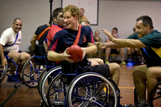 His Royal Highness Prince Henry of Wales – or Captain Harry Wales – as he is known in the British Army is undertaking a short duration attachment with the Australian Army. During his time with the 1st Brigade, Captain Wales joined both the wounded injured and ill Army members of the Soldier Recovery Centre; as well as other members of the 1st Brigade, for a game of wheelchair AFL (Australian Football League) The 1st Brigade is one of the Australian Army's three multi-role combat brigades and consists of more than 3,400 civilian and military personnel. Based at Robertson Barracks, Palmerston and located around 20kms south of Darwin in the Northern Territory; the 1st Brigade is home to armoured, cavalry, aviation, artillery, infantry, engineer and combat services support battalions. During his attachment with the Australian Army, Captain Wales will be working and living alongside Army members in various units and regiments. He is expected to spend time at Army Barracks in Darwin, Perth and Sydney. © Commonwealth of Australia, Department of Defence