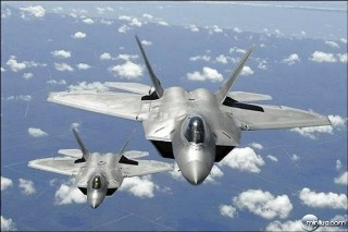 us-air-force-f-22-raptor-aircraft-flying-in-trail-behind-a-kc-135r-stratotanker_thumb