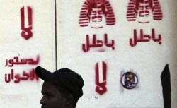 a mural of Egypts President Mohamed Mursi on the wall of the presidential palace in Cairo Reuters