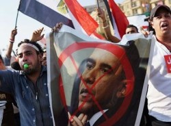 Egypt-protesters-carry-an-010