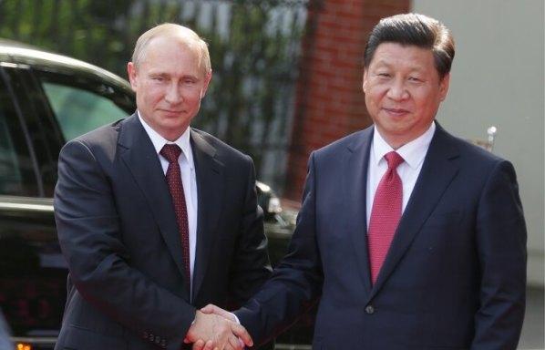 Russian President Vladimir Putin and Chinese President Xi Jinping ITAR-TASS Mikhail Metsel