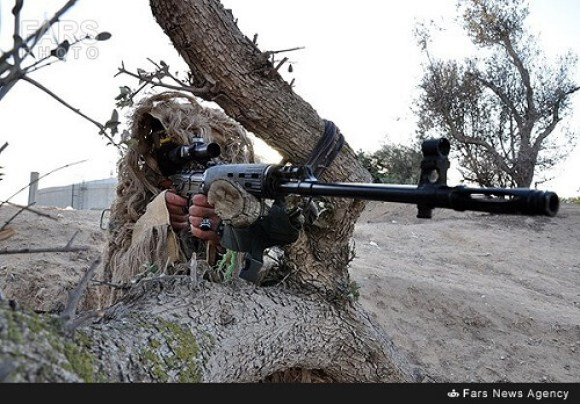 Sniper fire exercise from a camouflaged position