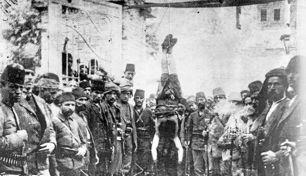 12 Turks hanging a Christian man upside down beating him to death for Allah