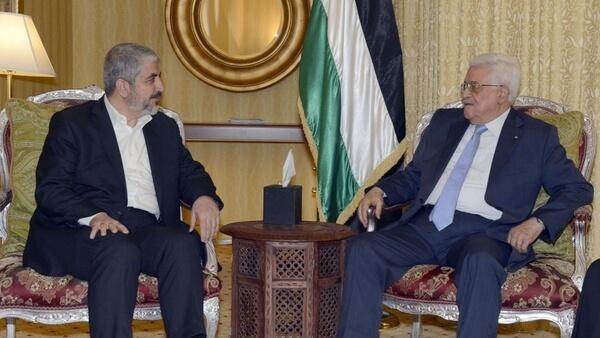 Mahmoud Abbas  meets with the Hamas political bureau chief Khaled Mashaal in Qatar July 20