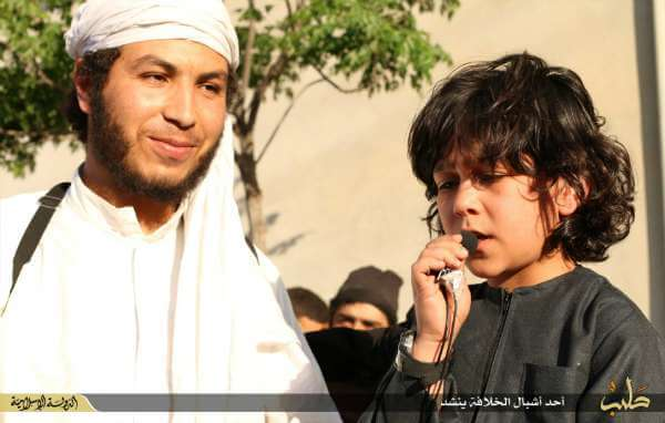 Child singing a nashid at an ISIS event in the town of Tadef near Aleppo