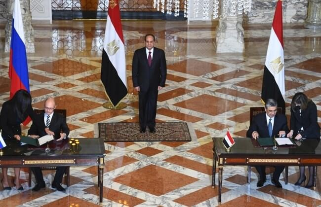 Sergei Kirienko director general of the Russian atomic energy agency Rosatom, and Egyptian electricity and renewable energy minister, Mohamed Hamid Shaker (R), signing an agreement to finance and build Egypt's first nuclear power plant as Egyptian President Abdel Fattah al-Sisi (C) looks on, at the presidential palace in Cairo on November 19, 2015.