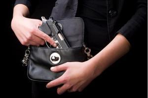 Woman Carrying Handgun