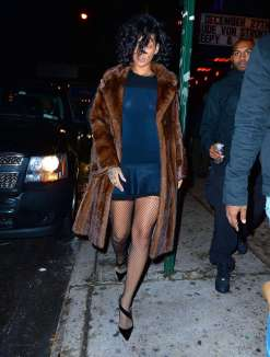 Rihanna at Marquee nightclub in NYC on December 18, 2013 fur