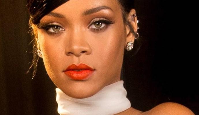 Rihanna poses for photos backstage at the amfAR Inspiration Gala October 29, 2014 rihanna-fenty.com