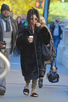 Rihanna heads to the Ocean's Eight set on November 7, 2016 holding coffee cup