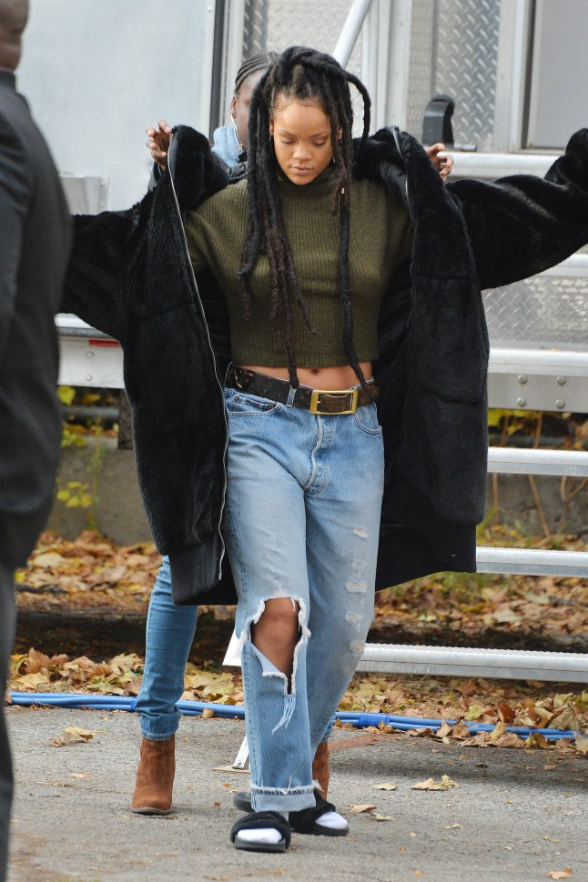 Rihanna on the set of Ocean's Eight on November 10, 2016 putting on a coat