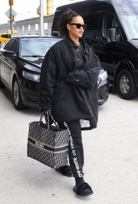 Rihanna arrives at JFK Airport on May 4, 2018 Off-White