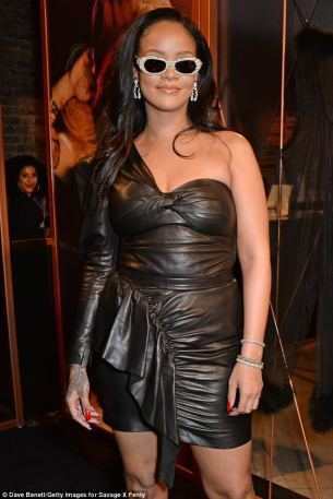 Rihanna visits Savage x Fenty pop up shop in London on June 15, 2018 Black dress
