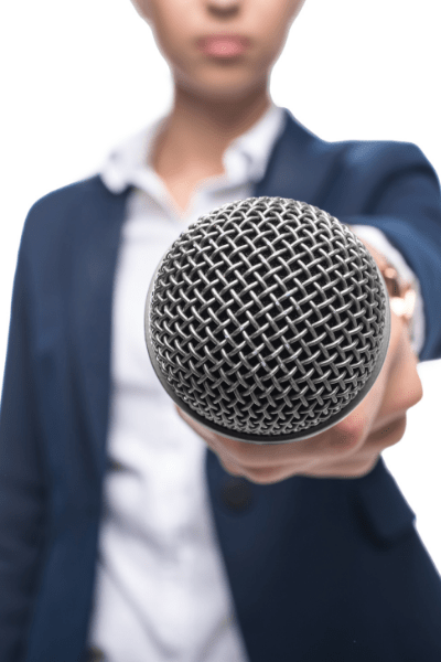 woman holds mic
