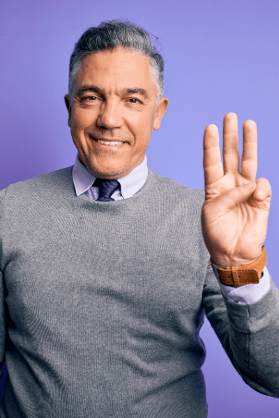 man shows sign for three