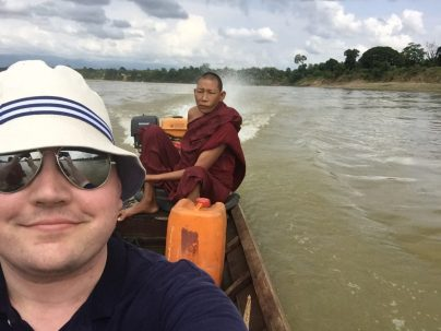 In a long boat on the Chindwin River.