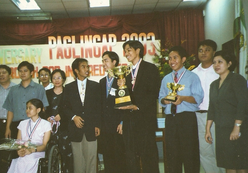 With his winning trainees in Trinity University of Asia