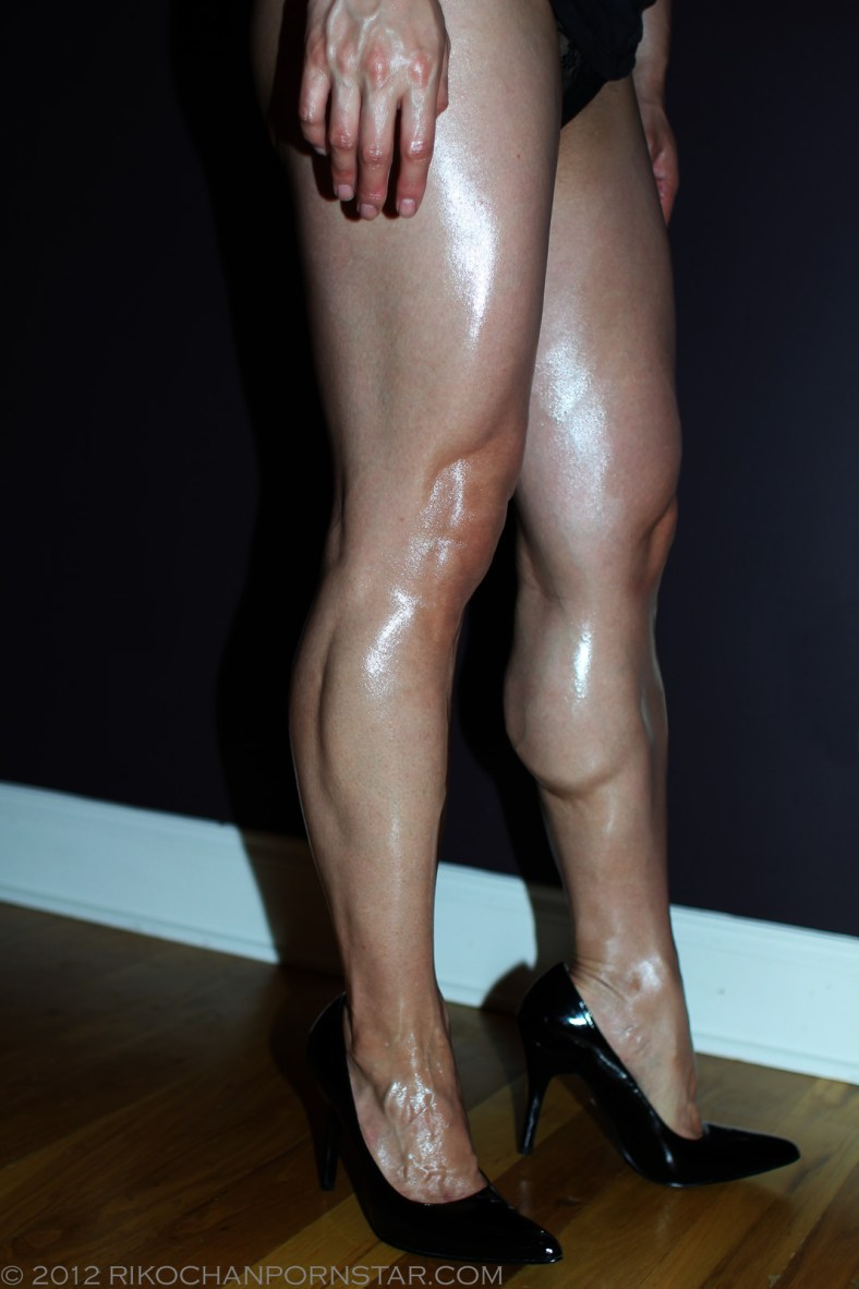 Oiled up muscular legs in high heels!