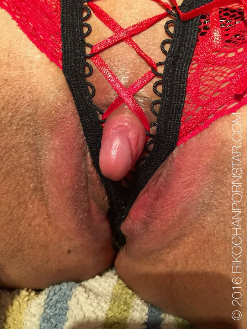 Pink clit poking through crotchless panties