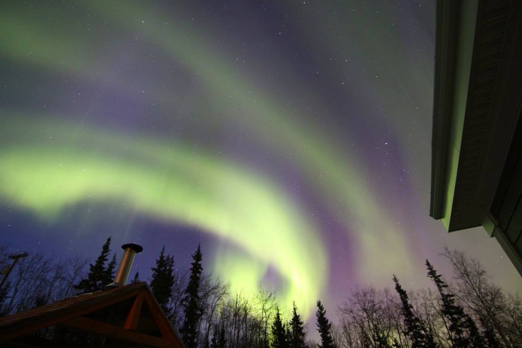 Photos of the northern lights over our Airbnb in Fairbanks